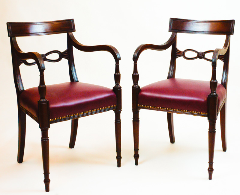 Matched pair of antique regency mahogany open arm chairs sn