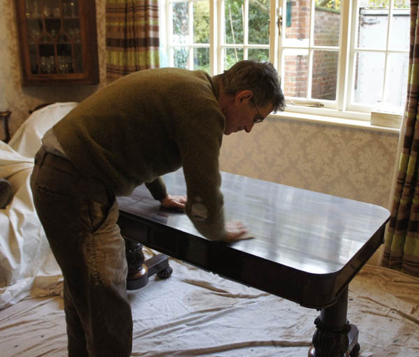 Jacob cleaning an Antique Walnut Writing Table